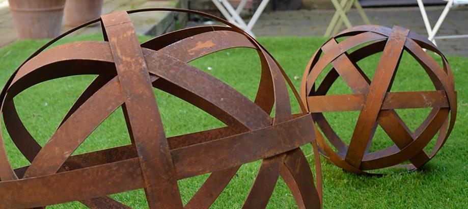 Header_garden-art-and-decor-patio-decor-rusty-band-balls